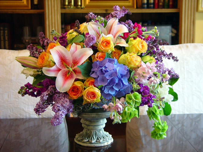 A lovely centerpiece for the Prince at Juddemonte Farms designed with Lilac, Stock, Belles of Ireland, Lilies, Roses.