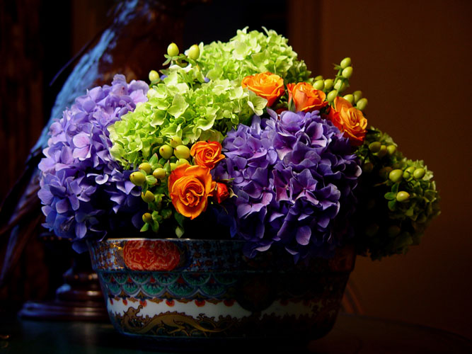 A centerpiece arrangement of purple hydrangeas | Floral Design by Chambliss Design