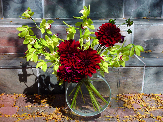 Contemporary Fall arrangement designed for art galley, with dahlias and orchids.