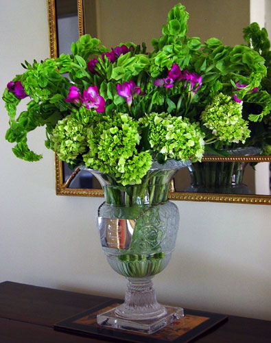 An arrangement in horse trophy filled with flowers | Chambliss Design