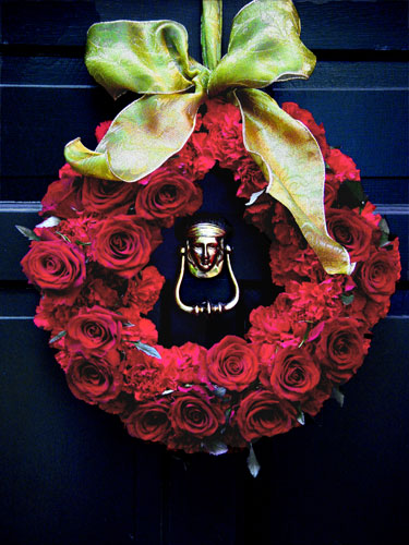 Christmas wreath of red roses and pavé carnations.