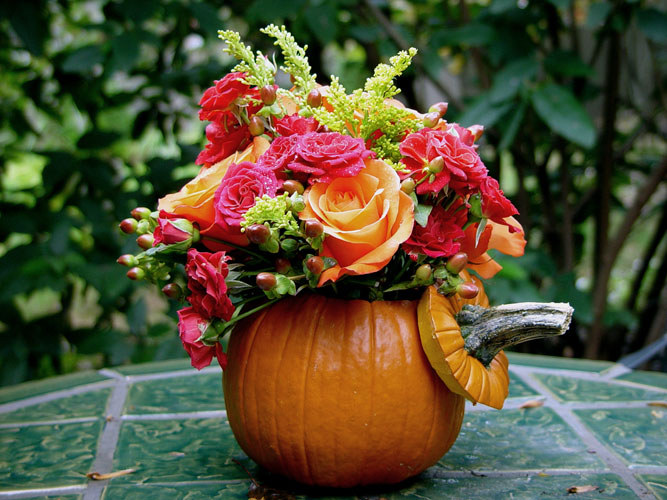 Adorable pumpkin filled with roses and asters