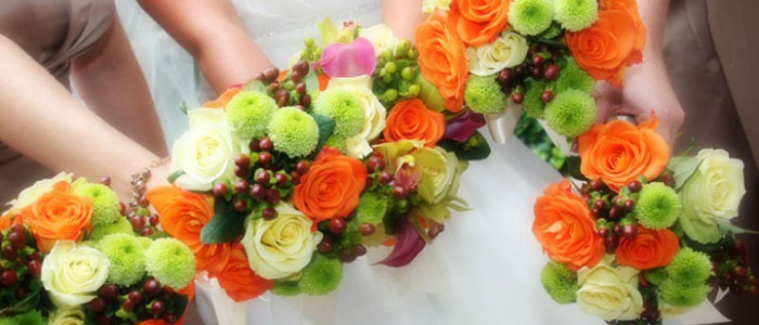 Wedding: bridal and bridesmaids bouquets of callas, roses, and hypericum.