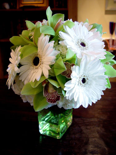 Wedding bridal bouquet of gerberas and pale green cymbidium orchids