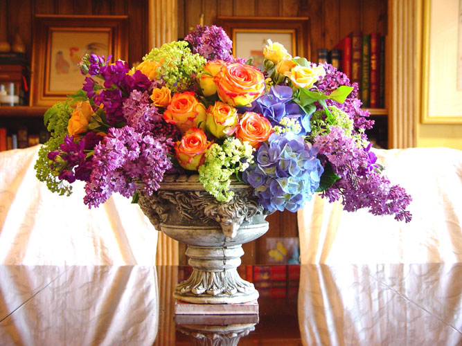 Fabulous flowers for a photo shoot for ELLE magazine designed with lilac, stock, belles of Ireland roses, and viburnum.