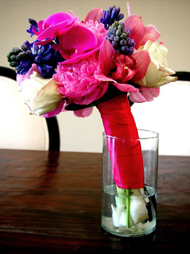 Wedding bouquet for bridesmaid designed with hyacinth peonies orchids and roses