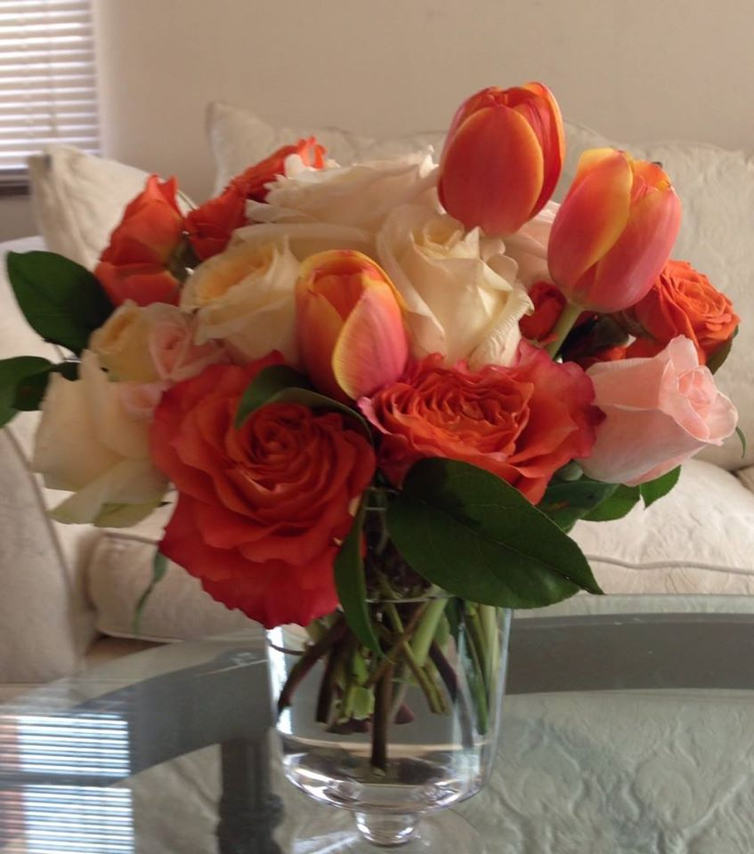 Centerpiece with peonies, tulips, roses, stock, lilies