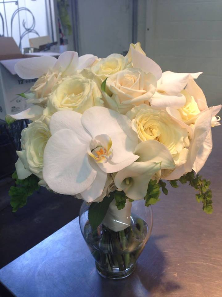 Bridal Bouquet with flowers of orchids calla lilies and roses.