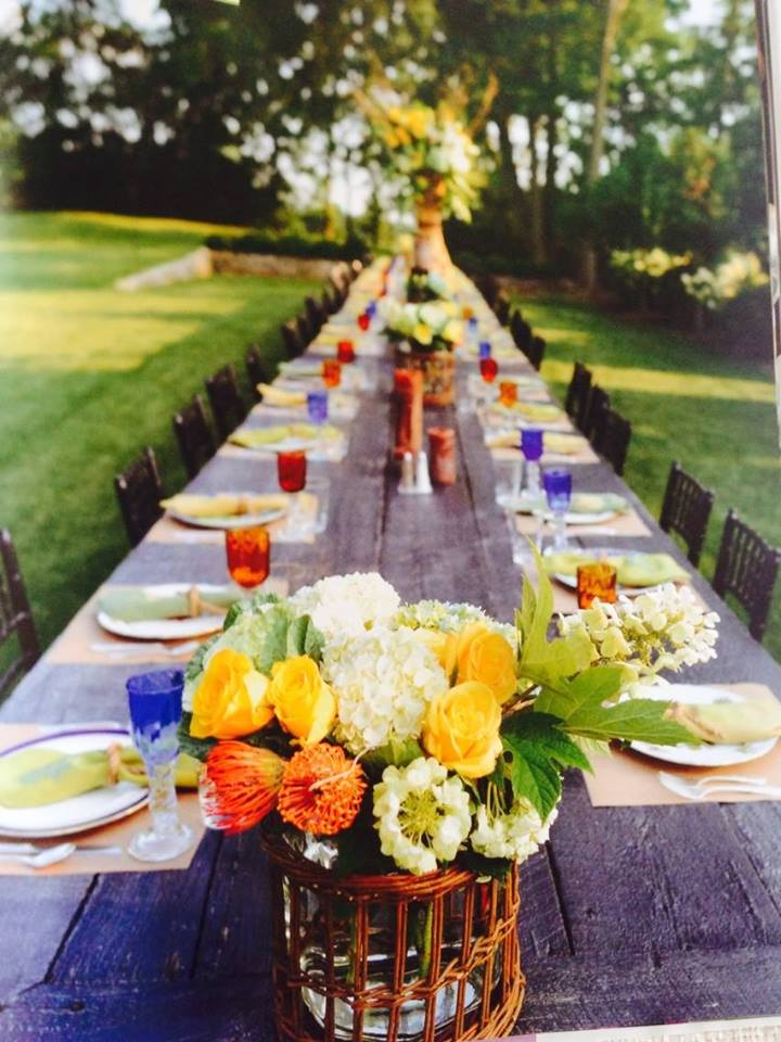 For an outside dinner,The center arrangement is 8 feet and container design was first proposed by Hollie Noel Chambliss and made by Roger Chambliss. This picture has been used in an Designer art book published by Rizzoli.