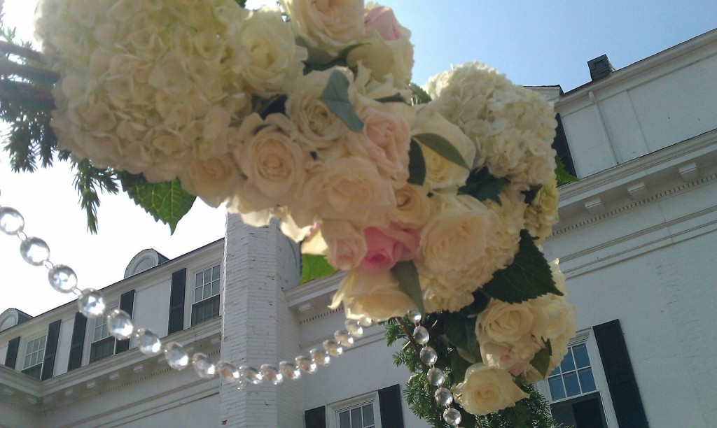 Arch covered with peonies, roses, hydrangeas