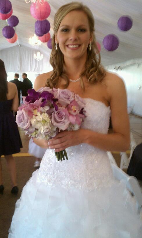 Bridal bouquet of iris orchids mums lavender hydrangeas and garden roses