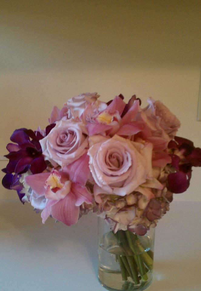Bridal bouquet of lavender hydrangeas and roses orchids and freesias