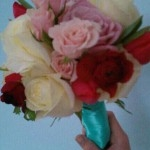 Bridesmaids bouquet of wine peonies tulips roses tied with tiffany blue ribbon