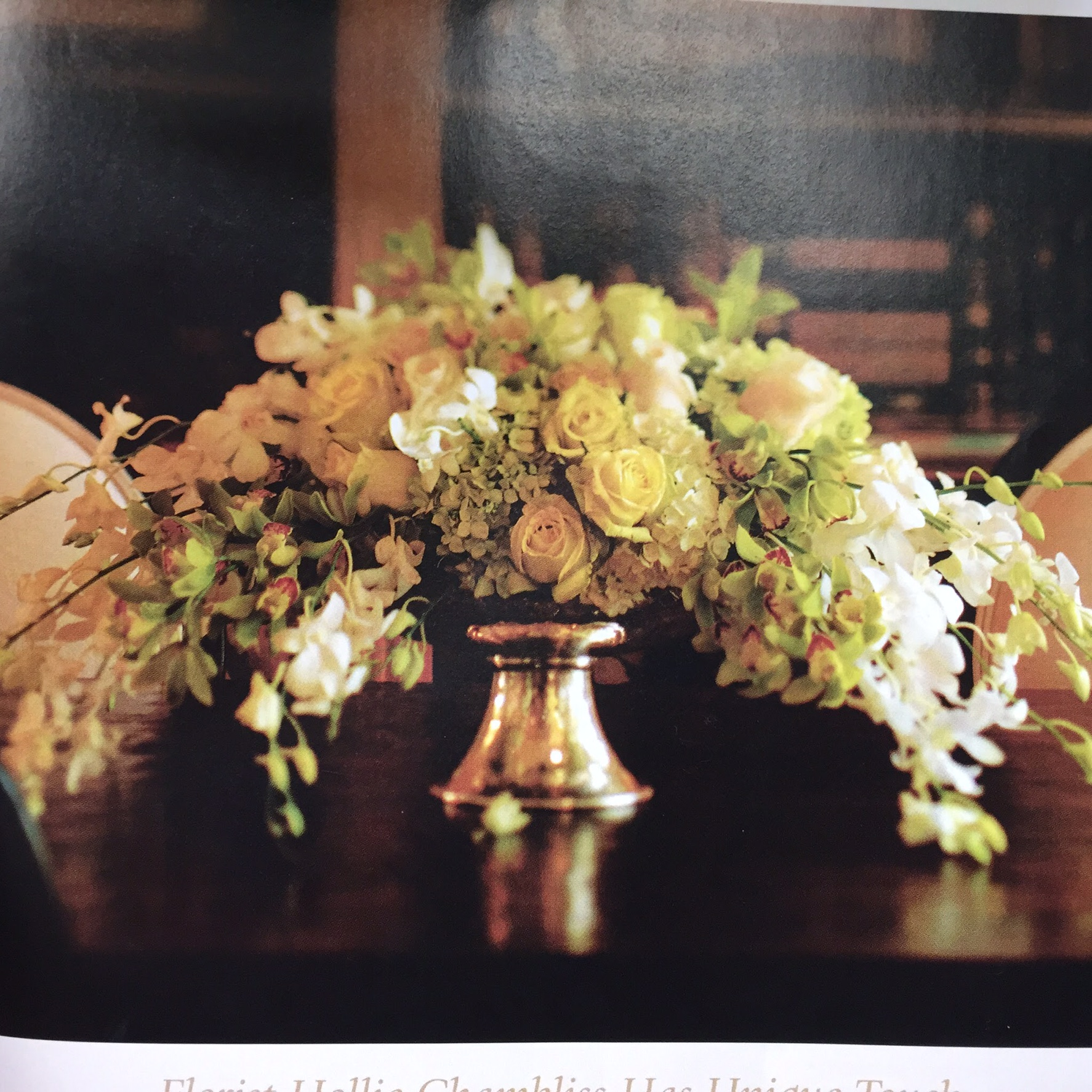 Cymbidium and Dendrobium orchids roses viburnum and hydrangeas in sterling silver bowl