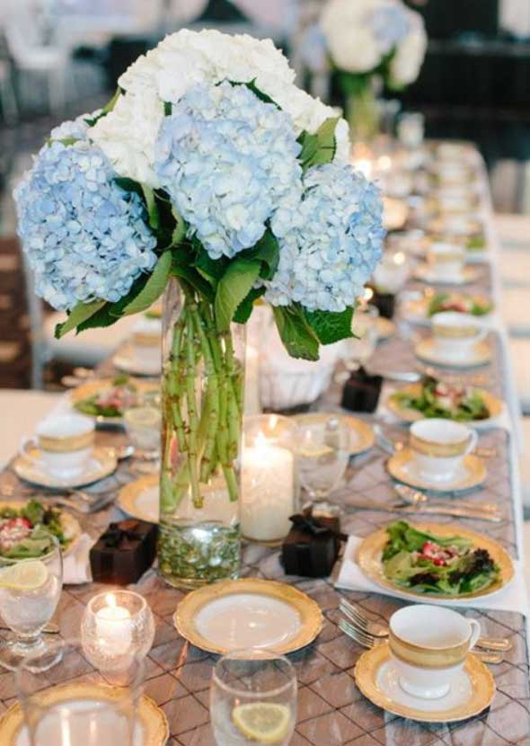 Elegant blue and white hydrangea wedding centerpiece at Carrick house