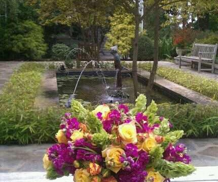 Photo shoot for Keeneland magazine.A flower arrangement of cranberry stock,mixed roses callas lilies and belles of Ireland.