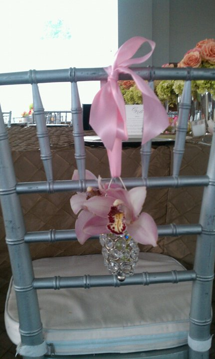 Simple and lovely for Bride and Groom's chair.Pink orchid in crystal.