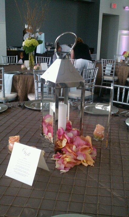 Wedding centerpiece at the Carrick House.Simple rose petals spilling out of lantern
