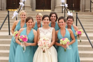 bridal and bridesmaids bouquets with pink orchids, garden roses, peonies, hydrangeas and freesia